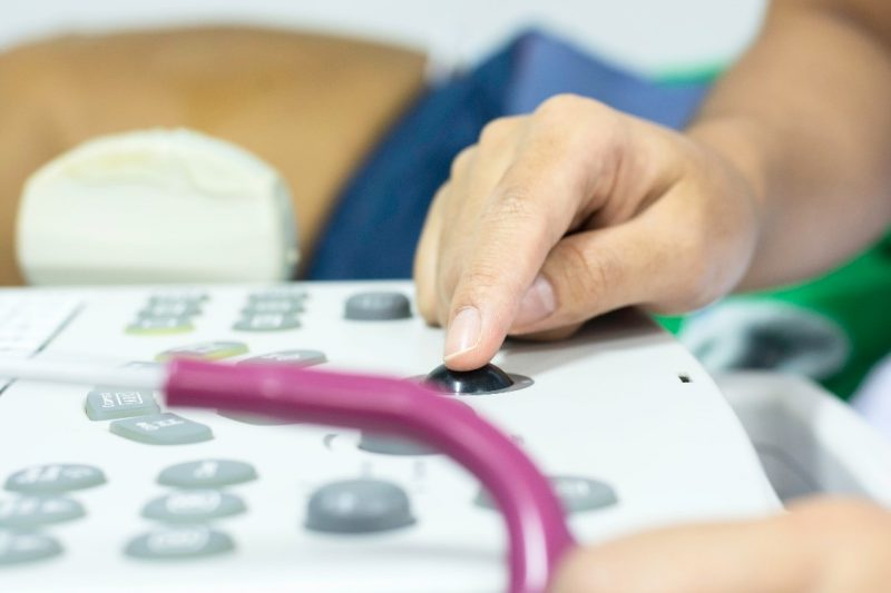 A doctor performs a point-of-care ultrasound diagnostic test.