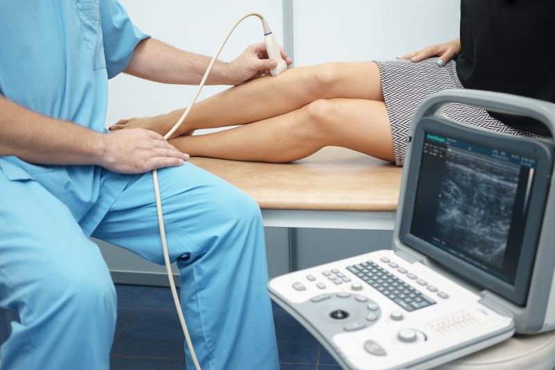 Doctor uses the 'best portable ultrasound machine' to scan a patient.